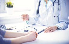 patient talking to a doctor