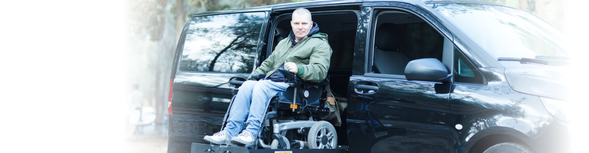 black van with a man on a wheelchair
